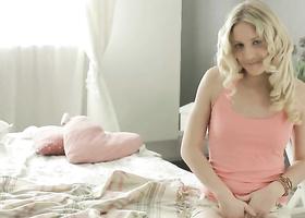 Blonde uses nimble fingers to gladden shaved vagina
