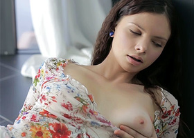 Enchantress in colored blouse enjoys fingers and dildo