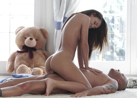 Young slut riding a big cock while her teddy watches
