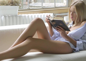 Blonde slut reading a book gets a dick in her mouth