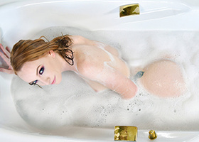 Sexy pale redheaded chick is taking a sexy bath